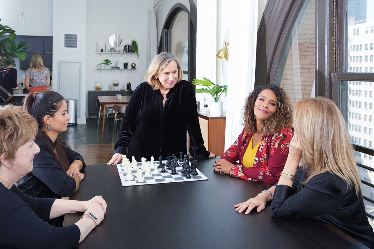 Ivona teaching Chess with a group of women.jpg